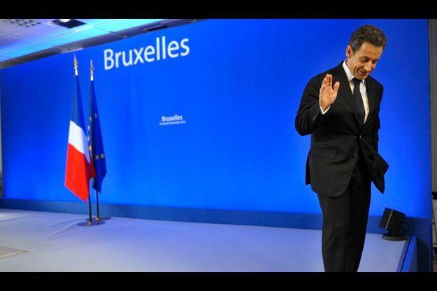 Nicolas Sarkozy quittant la conférence de presse vendredi matin, à Bruxelles.