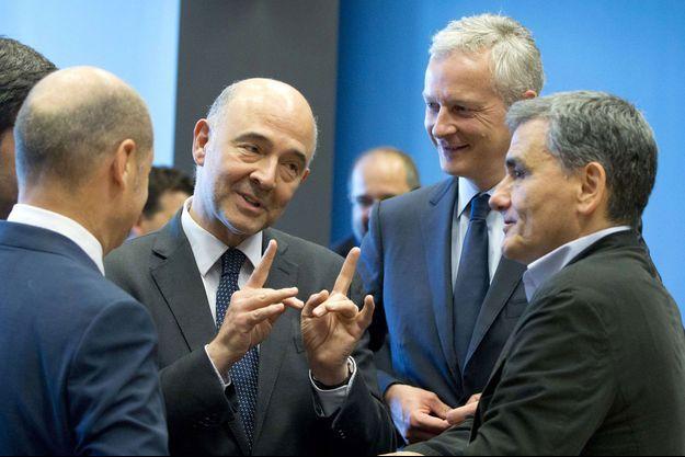 Pierre Moscovici, Bruno Le Maire et le ministre grec des Finances Euclide Tskalatos.