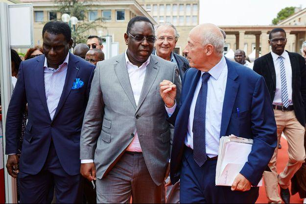 Jean-Hervé Lorenzi (à droite) avec le président du Sénégal, Macky Sall.