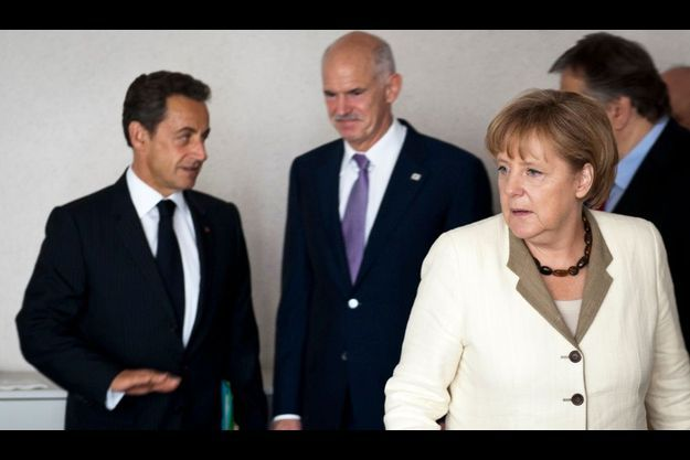 Nicolas Sarkozy, le Premier ministre grec Georges Papandreou et Angela Merkel