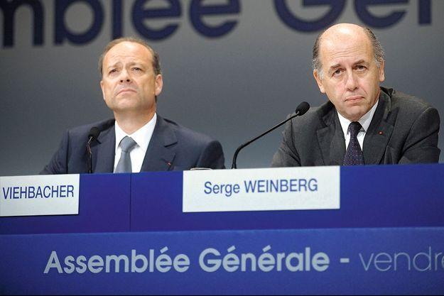 Chris Viehbacher, directeur général du géant français de la pharmacie et Serge Weinberg, le président du conseil d'administration.