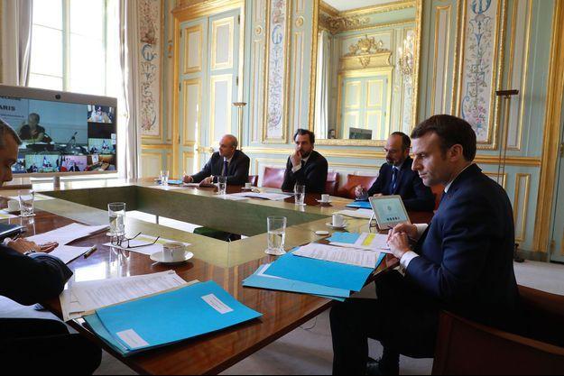 Lors de la visioconférence qui s'est déroulée jeudi à l'Elysée avec Emmanuel Macron et Edouard Philippe.