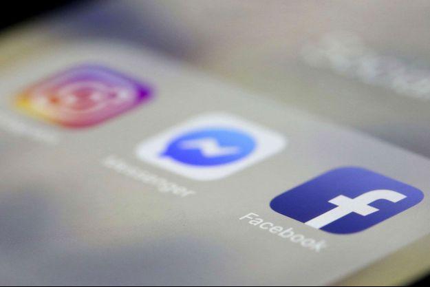 Les icônes de trois applications du groupe Facebook affichées sur un iPhone d'Apple : Facebook, Messenger et Instagram.