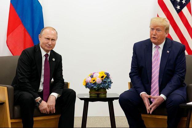 Donald Trump et Vladimir Poutine, le 28 juin au Japon.