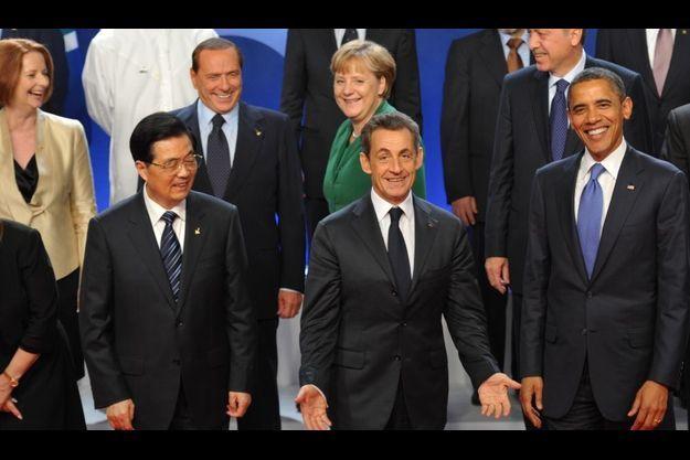Hu Jintao, Nicolas Sarkozy et Barack Obama ont le sourire.