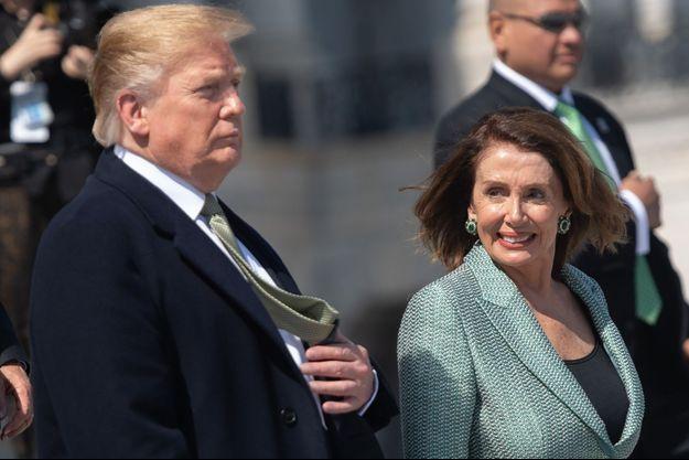 Donald Trump et Nancy Pelosi lors d'un événement organisé pour la venue du Premier ministre irlandais, le 14 mars 2019.