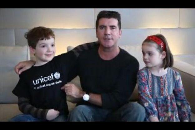 Charlie, ici en présence du producteur Simon Cowell et de sa petite soeur Alice.