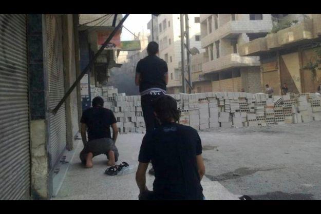 Des insurgés dans les rues de Damas.