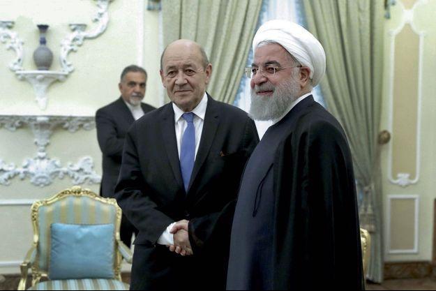 Jean-Yves Le Drian avec Hassan Rohani, le président iranien, lundi.