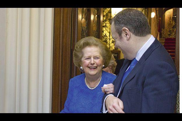 En juin dernier, lors d'une de ses rares sorties, à la Chambre des lords, Margaret Thatcher au bras du député conservateur Conor Burns, son visiteur du dimanche.