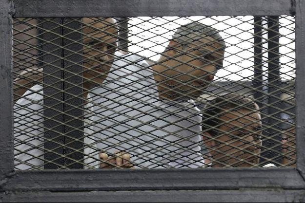 Peter Greste, Mohamed Fahmy et Baher Mohamed à la cour ce lundi.
