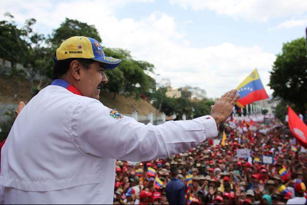 Nicolas Maduro lors d'un meeting de soutien à Caracas le 23 mars.
