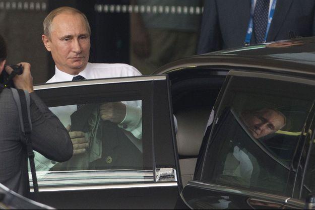 Vladimir Poutine quittant son hôtel de Brisbane.