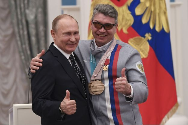Vladimir Poutine et le champion paralympique Valery Redkozubov