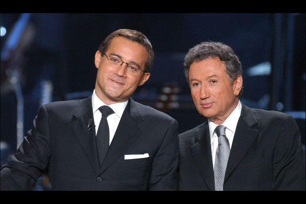 En 2003, Jean-Luc Delarue et Michel Drucker animent la soirée des Victoires de la Musique.