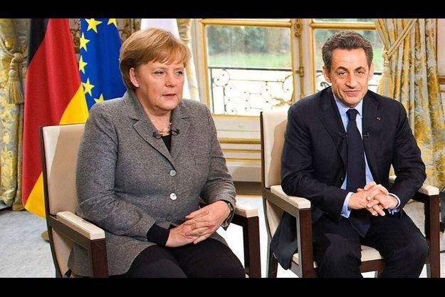 Angela Merkel et Nicolas Sarkozy, lors de l'interview télévisée.