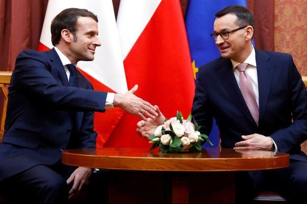 Emmanuel Macron et le Premier ministre polonais Mateusz Morawiecki, à Varsovie lundi.