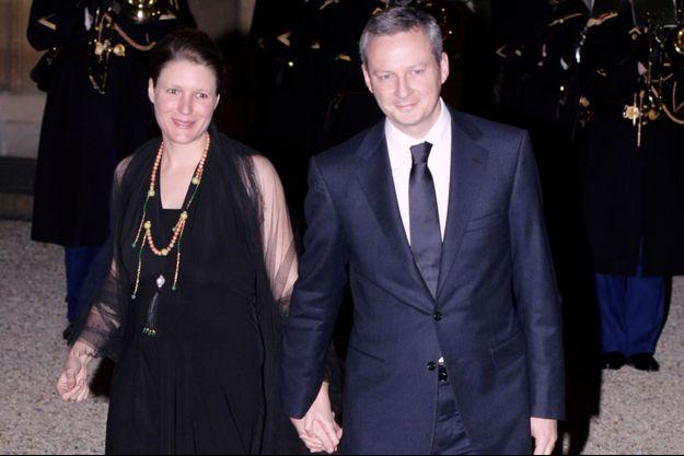 Bruno Le Maire, alors ministre de l'Agriculture, et sa femme, Pauline, devant le palais de l'Elysée, en mars 2011.