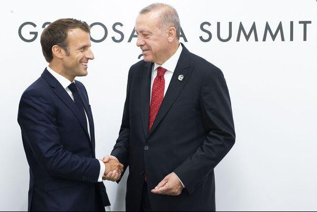 Recep Tayyip Erdogan et Emmanuel Macron lors d'une réunion bilatérale en marge du sommet du G20 à Osaka, Japon, le 28 juin 2019
