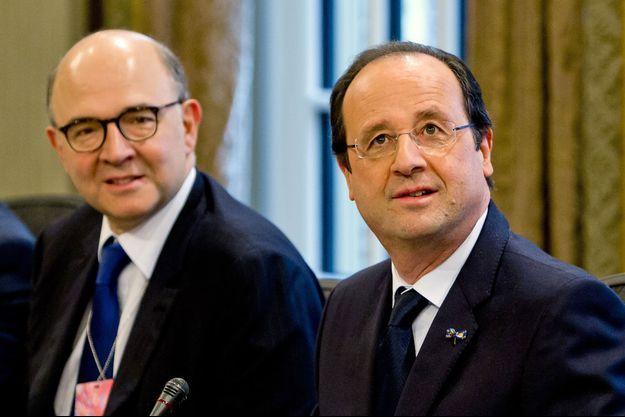 Pierre Moscovici et François Hollande, en janvier dernier.