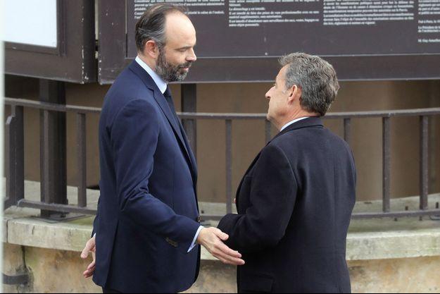 Edouard Philippe et Nicolas Sarkozy, il y a un an, le 11 mars 2020 lors d'une cérémonie à Paris en hommage aux victimes du terrorisme.
