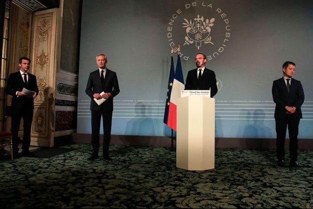 Olivier Véran, Bruno Le Maire, Edouard Philippe et Gérald Darmanin, mercredi en conférence de presse à l'Elysée.