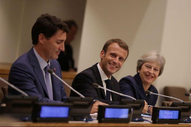 Justin Trudeau, Emmanuel Macron et Theresa May.
