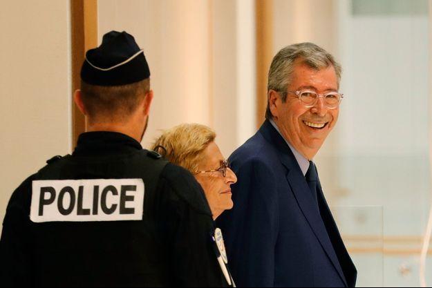 Patrick et Isabelle Balkany, au palais de justice de Paris, le 13 septembre, avant l'énoncé de leur premier jugement.