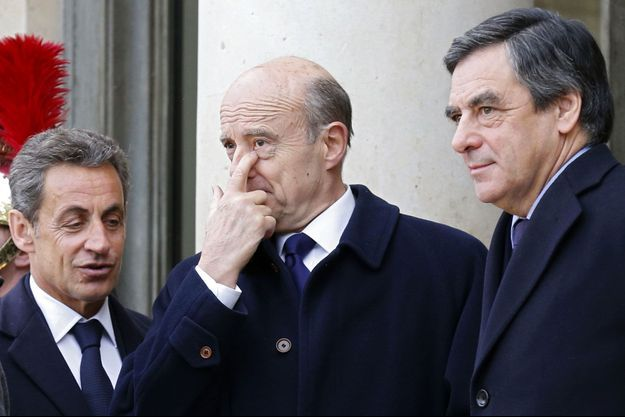 Nicolas Sarkozy, Alain Juppé et François Fillon sur le perron de l'Elysée, le 11 janvier dernier.