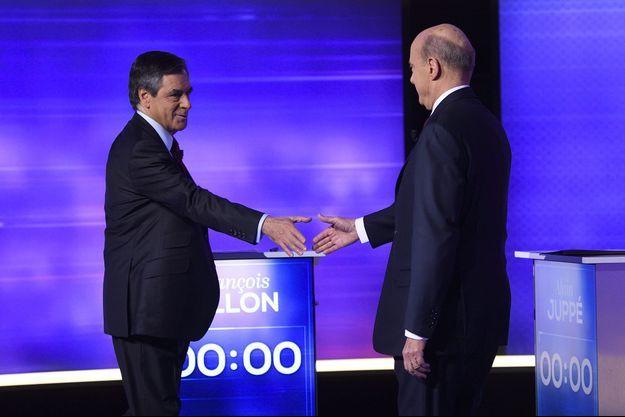 François Fillon et Alain Juppé, jeudi soir, sur le plateau du débat.