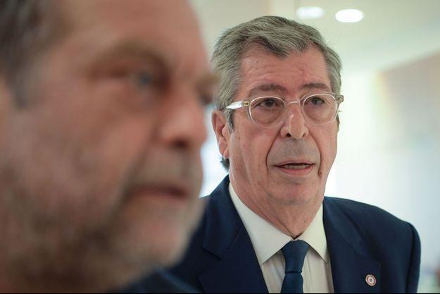 Patrick Balkany et son avocat Eric Dupond-Moretti, à Paris le 19 juin 2019.