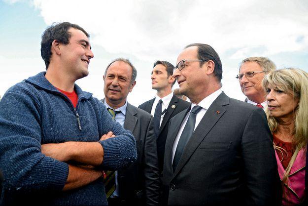 François Hollande et Sophie Dessus, députée socialiste de la Corrèze, en déplacement à Gros-Chastang
