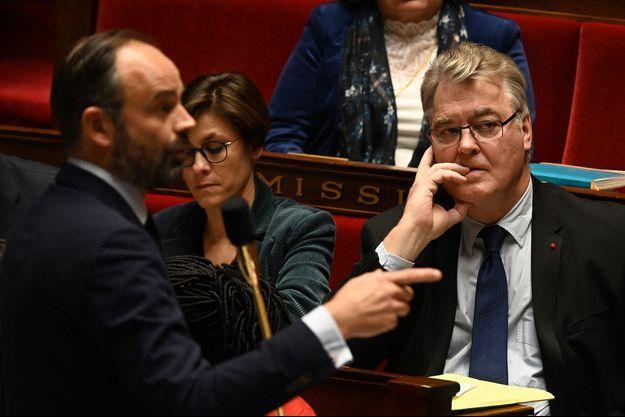 Edouard Philippe et Jean-Paul Delevoye à l'Assemblée nationale, mardi.