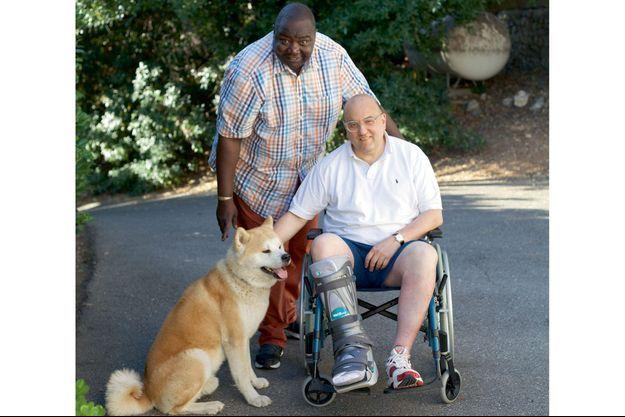 Fodé Sylla, Julien Dray et le chien Ekyo.