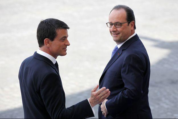 Le président Francois Hollande et son Premier ministre Manuel Valls, lors du défilé du 14 juillet.