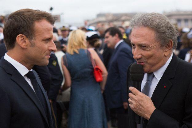 Emmanuel Macron et Michel Drucker, lors de cérémonies du 14 juillet 2019.