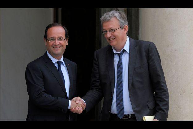 François Hollande et Pierre Laurent le 4 juin 2012 à l'issue d'une rencontre à l'Elysée.