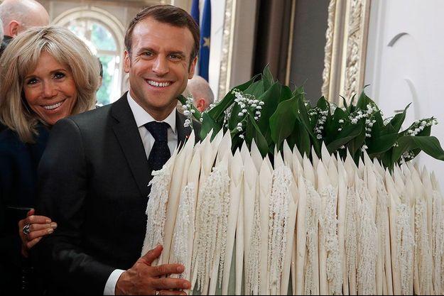 Emmanuel et Brigitte Macron, lors du 1er mai 2019 à l'Elysée.
