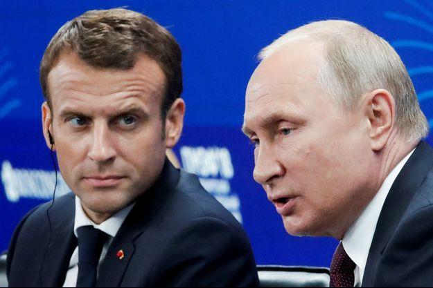 Emmanuel Macron et Vladimir Poutine.