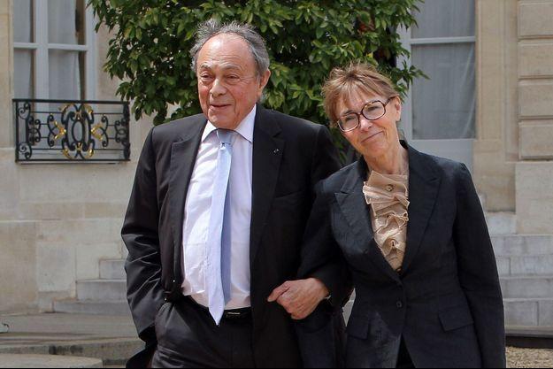 Michel et Sylvie Pélissier dans la cour de l'Elysée en mai 2012.
