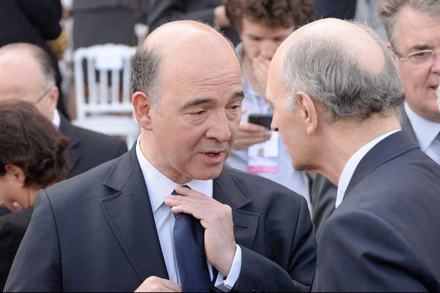 Pierre Moscovici en pleine discussion avec Didier Migaud.