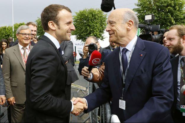 Emmanuel Macron et Alain Juppé ici à Villepinte en 2016.