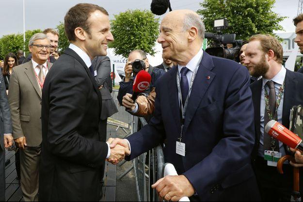 Emmanuel Macron et Alain Juppé en juin 2016 à Villepinte