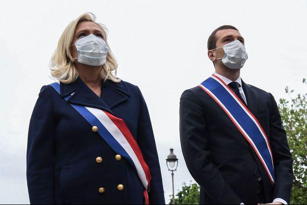 Marine Le Pen et Jordan Bardella, lors d'une cérémonie le 1er mai à Paris.