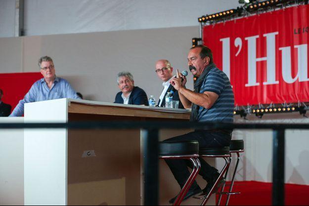 Jean-Paul Delevoye (à g.) et Philippe Martinez (à dr.), samedi, à la Fête de l'humanité, lors d'un débat.