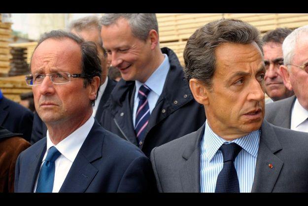 Avril 2011, les deux futurs candidats visitent une scierie à Tra-le-Bos (Centre).