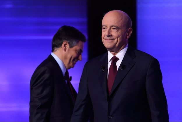 Alain Juppe et Francois Fillon, jeudi soir lors du débat de l'entre deux tours.