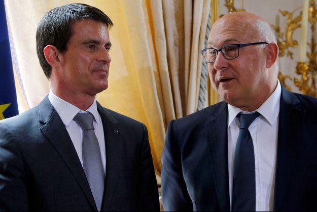 """Selon Michel Sapin, Manuel Valls serait le """"candidat naturel"""" si Hollande ne se présente pas"""