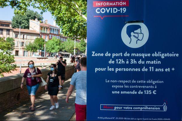 Pancarte de réglementation pour endiguer le covid-19 à Toulouse.