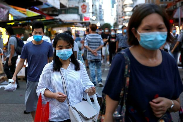 Des habitants de Hong Kong, le 17 juillet.